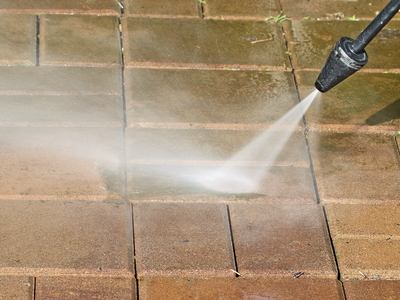 Power washing helps keep dirt and grime from building up in patio stones.
