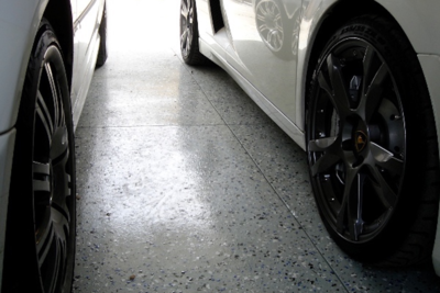 A high-solids epoxy floor will not peel or curl where tires rest on it, Seth Thompson, owner of Texas Tough Tops, said.