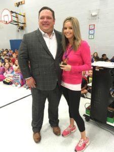 Jason Rehg presents a teaching award to Katie Miller.