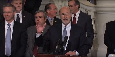 Pennsylvania's Democrat Gov. Tom Wolf gestures during comments just prior to singing pension reform in that state.