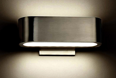 Wall sconces offer a bit of personality with fun, modern designs, like this model from Nia.