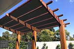 Many homeowners are opting to add extra shade to existing pergolas.