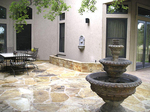 A flagstone finish on an outdoor hardscape creates a rustic, natural look.