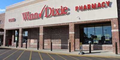 A woman claims that she was caused to slip and fall in a Winn-Dixie.