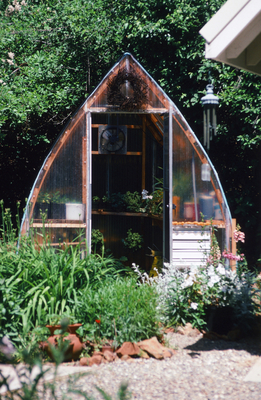 This sweet little A-frame greenhouse is easy to screen off from the rest of the ornamental landscape, or it can be a visual part of it too.