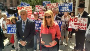 The Thomas More Society's Stephen Crampton and Veronica Price speak at a press conference outside of Chicago Planned Parenthood.