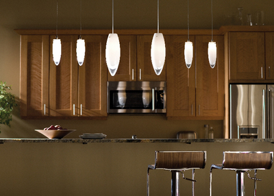 Pendant lighting adds ambiance to a kitchen.