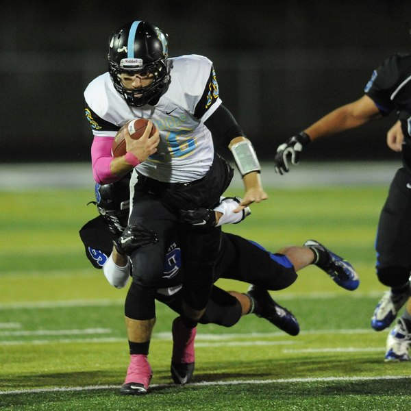 A Maine West player outruns the competition.