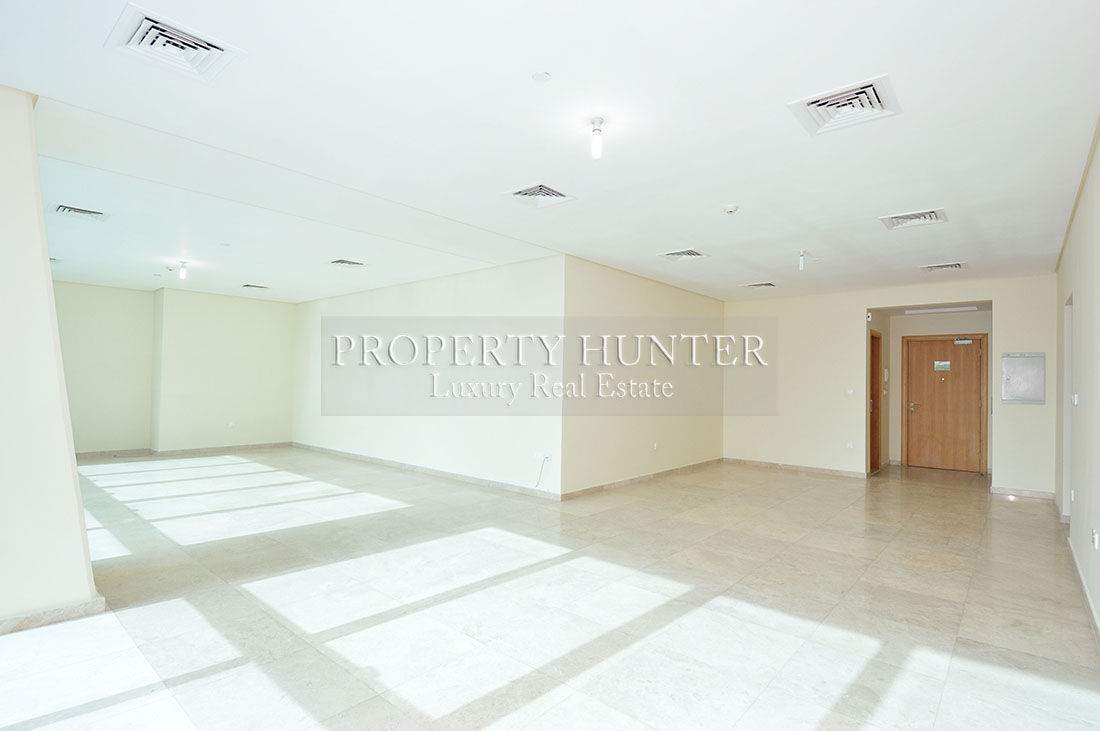 This is the living space in the avaialble three bedroom apartment at Zig Zag Tower.