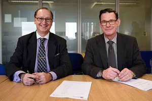 The University of Bristol's Andrew Nix, left, engineering faculty dean, and NNL Chief Scientist Andrew Sherry sign a memo of understanding to collaborate on nuclear energy.