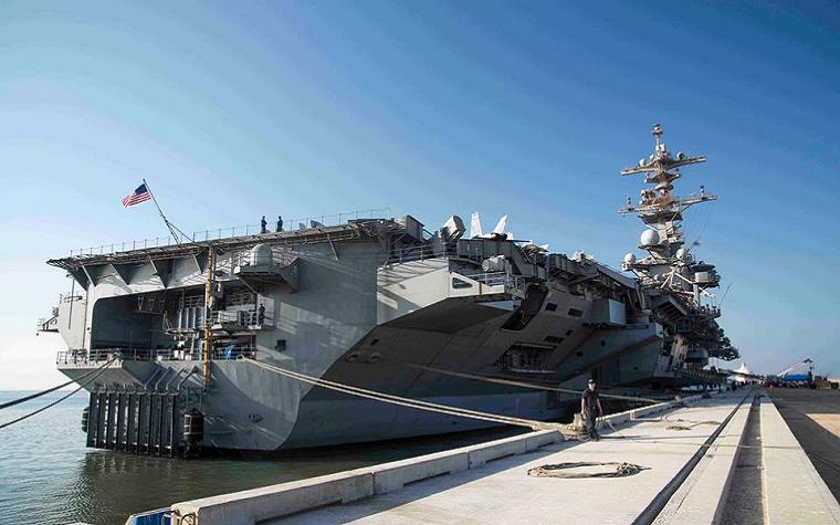 The aircraft carrier USS George H.W. Bush (CVN 77) docks pier side in the port of Duqm, Oman.