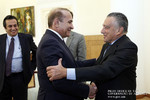 The Republic of Armenia Prime Minister Hovik Abrahamyan, left, receives Argentine-Armenian businessman Eduardo Eurnekian.