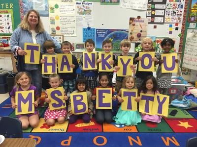 Children at Baldwin Elementary School say goodbye to Betty Johnson, retiring head custodian.