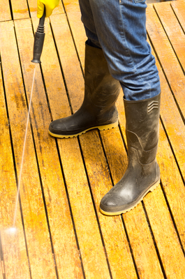 Power washing is part of the process to fix a deck with flaking stain.