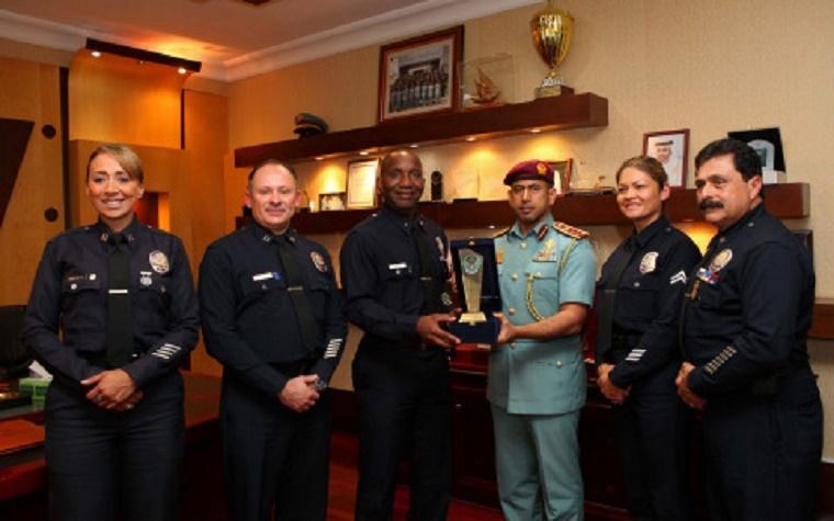 Col. Al Shamesi presents a commemorative shield to the Head of the US delegation.
