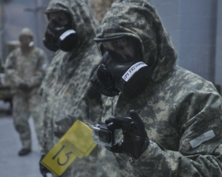 Capt. Maria Frishman helps lead a chemical-threat response drill with paratroopers and a live chemical agent this week at Fort Leonard Wood in Missouri.