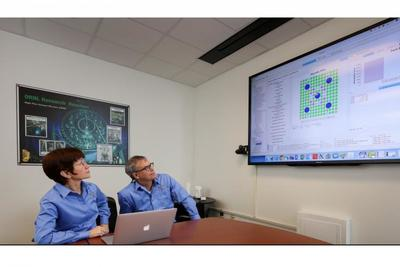 Germina Ilas (left) and Ian Gauld review spent fuel data entries in the SFCOMPO 2.0 database.