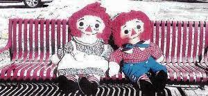 Raggedy ann andy on red bench