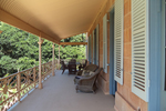 Many homeowners are returning to designs of yesteryear when homes came with a large, covered porch area.