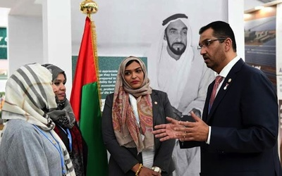 UAE Minister of State and Special Envoy for Energy and Climate Change Sultan Ahmed Al Jaber talks sustainability with visitors to the UAE's pavilion at the COP21 climate conference in Paris.