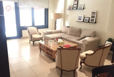 The living room in the available one bedroom apartment in The Pearl