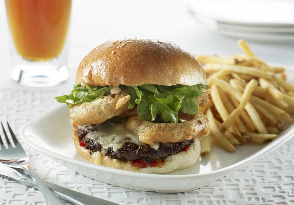 The hand-smashed burger is one of the most popular dishes at Earl's, with homemade ingredients and prepared fresh from scratch.