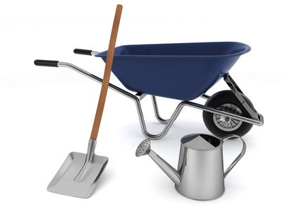 A garden tool collection should include the basics like a wheelbarrow, watering can and a good shovel.