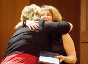 Cindy White presents Elizabeth Stark of First Mid-Illinois Bank & Trust with the Chamber's Diplomat of the Year distinction.
