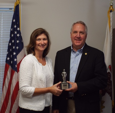 "Kim Maisch, NFIB Illinois state director, presents John Shimkus with his ""Guardian of Small Business"" award."