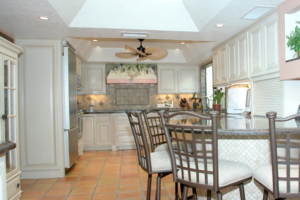 White cabinets, and brighter colors altogether, are a growing trend in kitchen design recently.