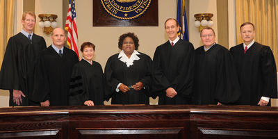 The Supreme Court of Louisiana. From left: Justice Jefferson D. Hughes, III, Justice Greg G. Guidry, Justice Jeannette Theriot Knoll, Chief Justice  Bernette Joshua Johnson, Justice John L. Weimer, Justice Marcus R. Clark, Justice Scott J. Crichton.