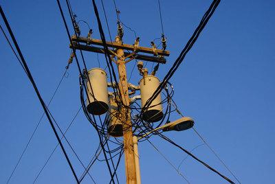 Medium telephone pole electric lines