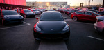 Smart Summon allows Tesla cars to drive themselves through parking lots.