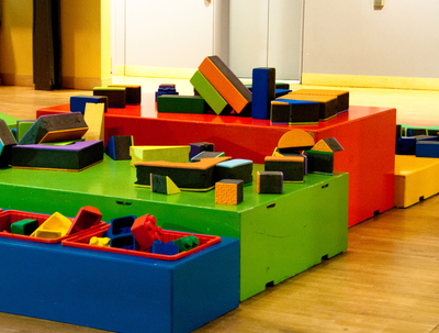 A designated play area creates space for long-term building projects.