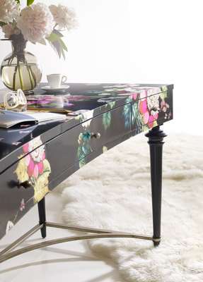 The Fleur De Glee Writing Desk boasts a bold floral pattern and attractive drawer pulls.
