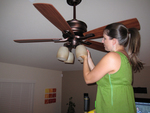 Ceiling fans work with air conditioning to reduce cooling costs.