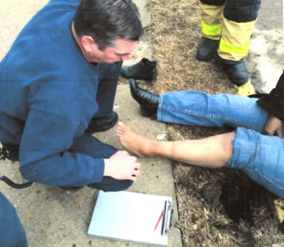 Photo attached to Evans' lawsuit purporting to show firemen rescuing her