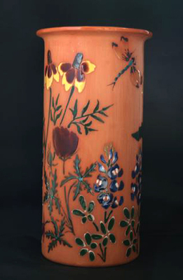 This terra cotta vase can also be used as a wine cooler.