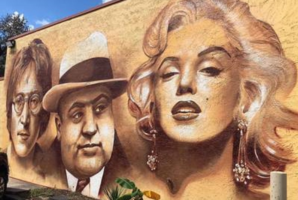 The mural of John Lennon, Al Capone and Marilyn Monroe, painted by an internationally recognized artist, adorns the outside wall of Moe's Southwestern Grill in Mt. Pleasant, SC.