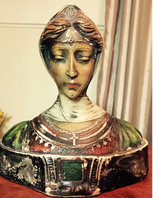 This plaster bust is of a 13th century Italian woman who captured the heart of a famous poet.