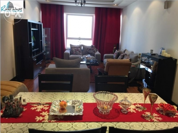The furnished living room of the available penthouse.