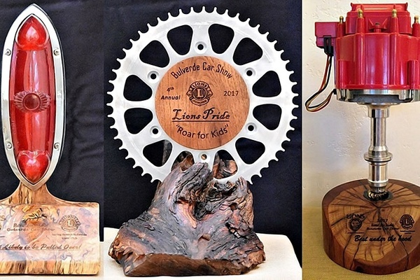The Roar for Kids Car Show is known for its handmade trophies such as this year's awards for (left to right) Most Likely to Be Pulled Over, Lion's Pride and Best Under the Hood.