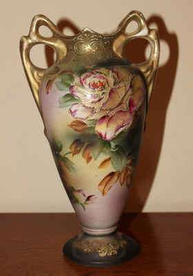 The painting on this vase is extravagant, but the wear to the gilding will reduce its value.