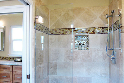 Many homeowners are opting to take out the tub and put in a frameless shower stall.