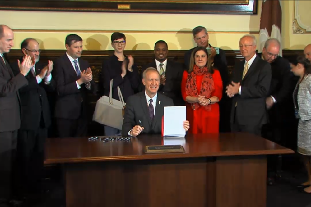 Gov. Bruce Rauner signs the Small Wireless Facilities Deployment Act on Thursday.
