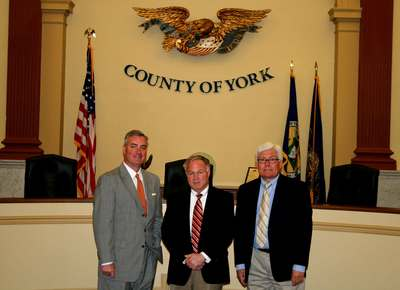 York County Commissioners, from left Chris Reilly, Doug Hoke and Steve Chronister on Wednesday approved refinancing $74 million in debt from the construction of the county's judicial center.