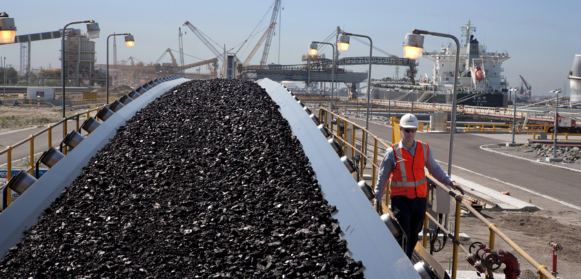 A mining technician oversees a coal export terminal.