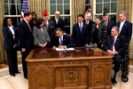 President Barack Obama signs an employment bill for veterans, which remain slightly higher than the general population in unemployment rates.