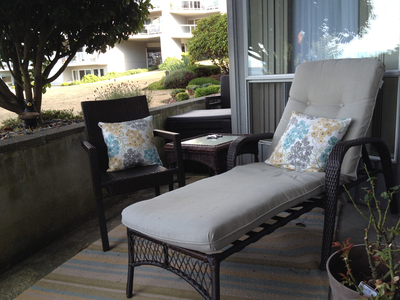 With the right furniture pieces, an outdoor area can be an escape for reading and relaxation.