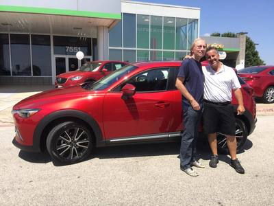 John Bosch was the first person in the U.S. to buy a Mazda CX-3, at Roger Beasley Mazda in Georgetown.